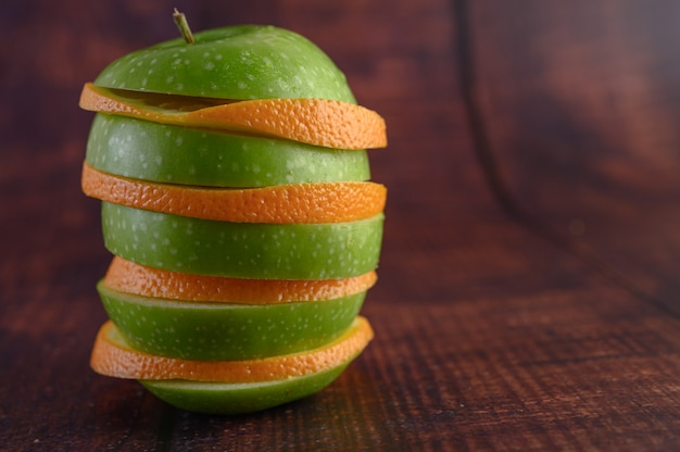 The fruits are arranged in layers with apples and oranges.