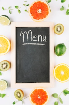 Fruits around blackboard with menu writing