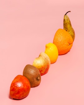 Fruits assortment on pink background