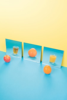 Fruits on blue table isolated on yellow