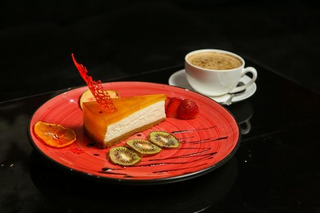 Fruits cheesecake kiwi orange strawberry coffee side view