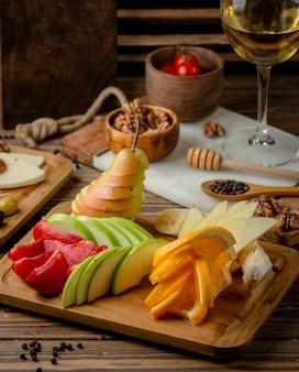 Fruits in cutting board