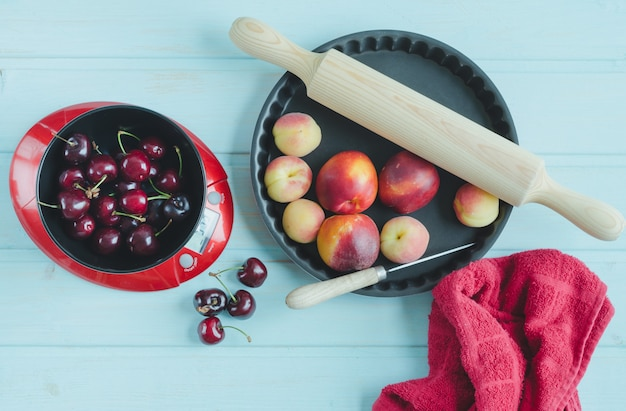 Fruits and kitchen utensils. top view.