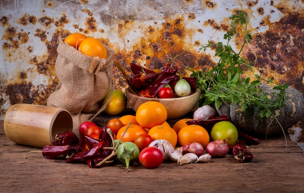 Fruits and mixed vegetables on old wooden table