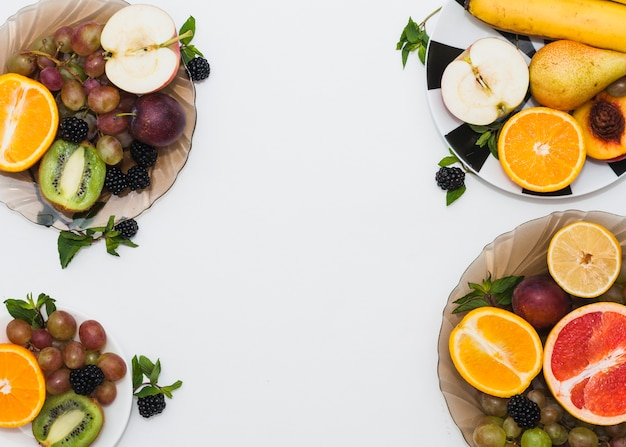 Fruits plates on white background