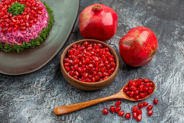 Fruits seeds of pomegranate spoon an appetizing dish