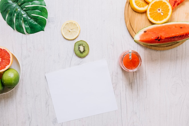 Fruits and smoothie near paper sheet