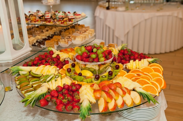 Fruits and tasty cakes on wedding banquet