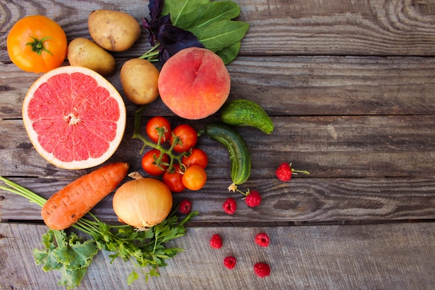 Fruits, vegetables diet on wooden background