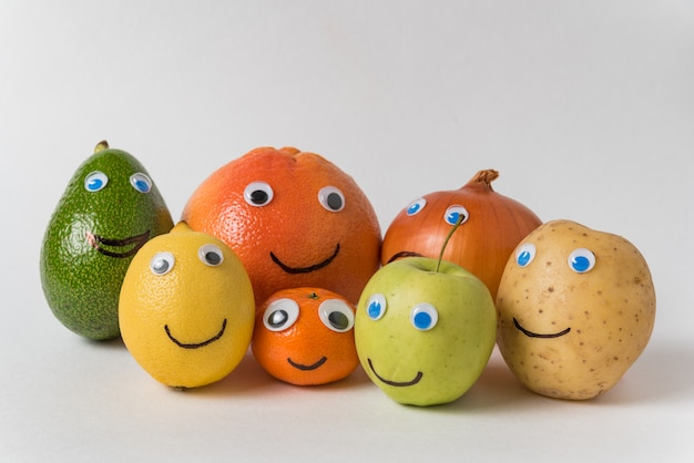 Fruits and vegetables in form of characters with funny faces. big happy family concept