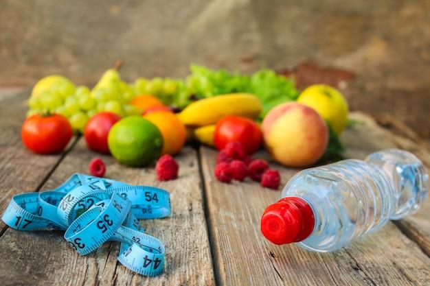 Fruits, vegetables, measure tape, water