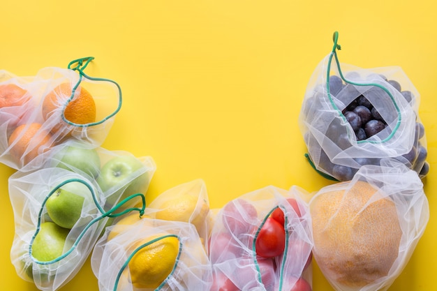 Fruits and vegetables in mesh bags.