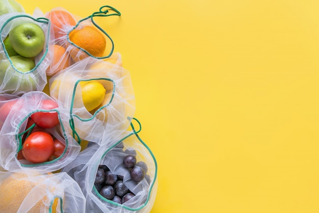Fruits and vegetables in reusable bags.