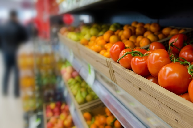 Fruits and vegetables on shelves in supermarket. selected focus