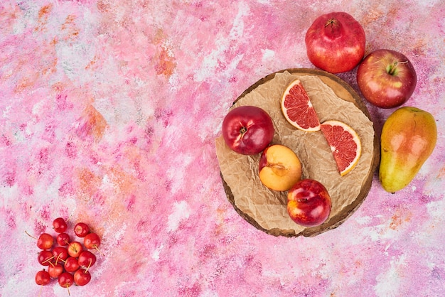 Fruits on wooden platter.