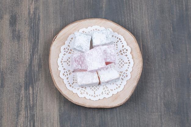 Fruity sweet treats on wooden piece