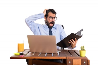 Frustrated businessman in his office with his folder