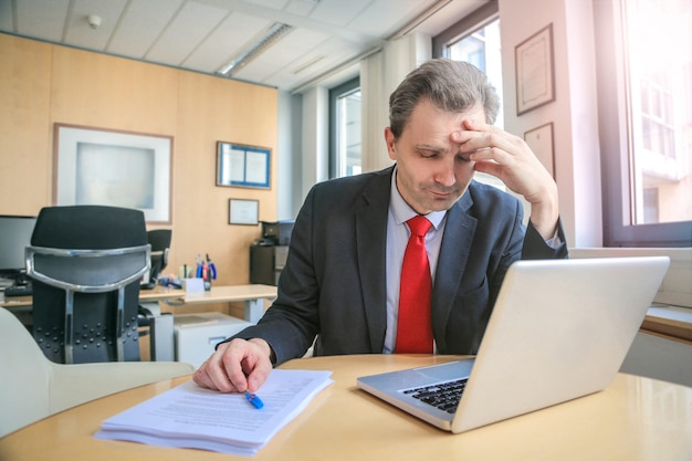Frustrated businessman in the office