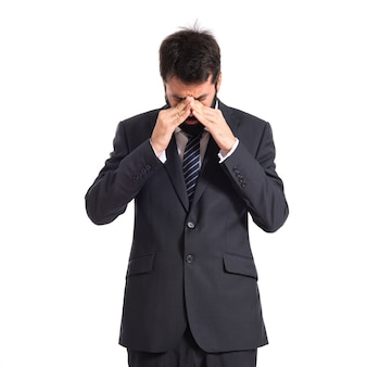 孤立した白い背景上の挫折したビジネスマン