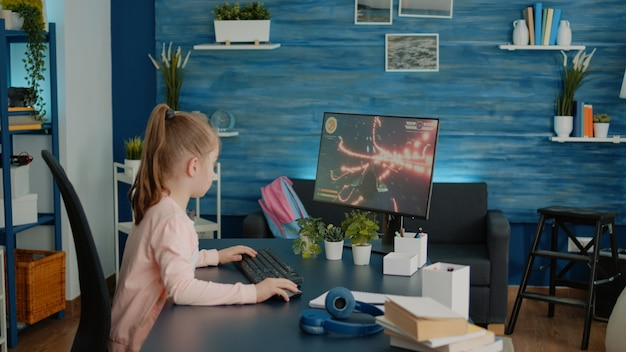 Frustrated child losing at video games on computer