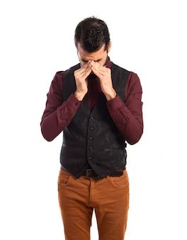 Frustrated man wearing waistcoat