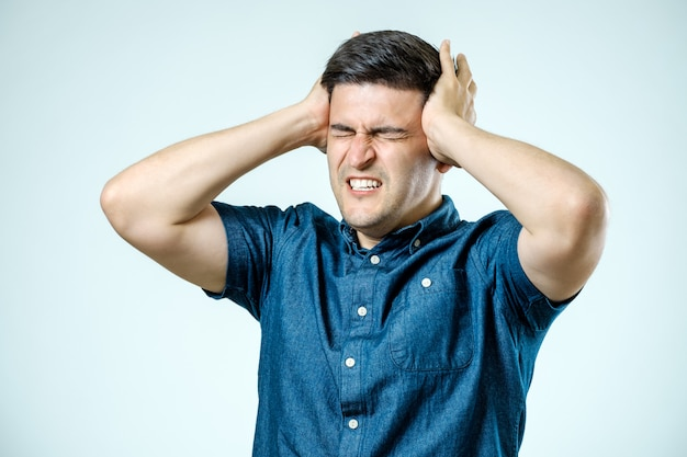 Frustrated man with headache isolated