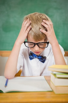 Frustrated student reading books