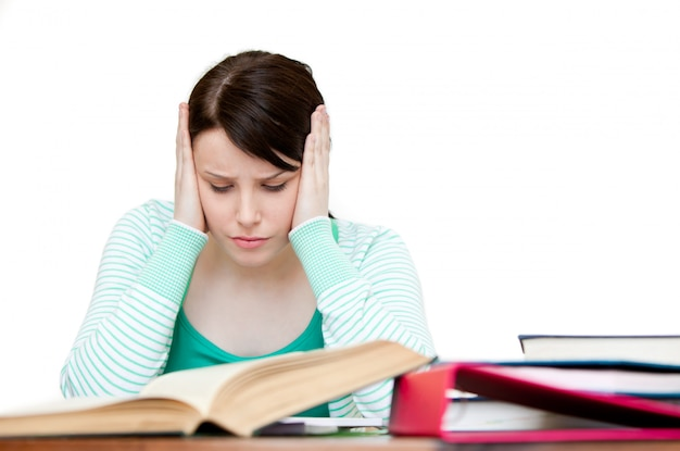 Frustrated teenager doing her homework