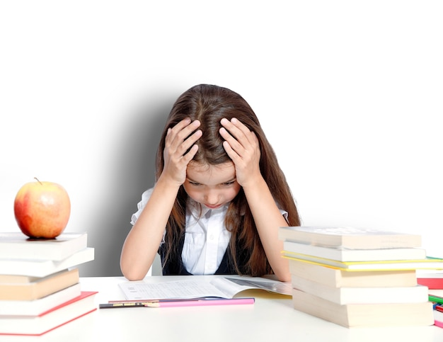 Frustrated and unhappy teen girl at school.