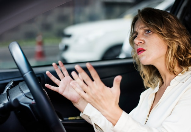 Frustrated woman stuck in traffic