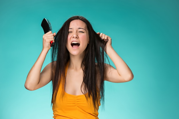 Frustrated young woman having a bad hair