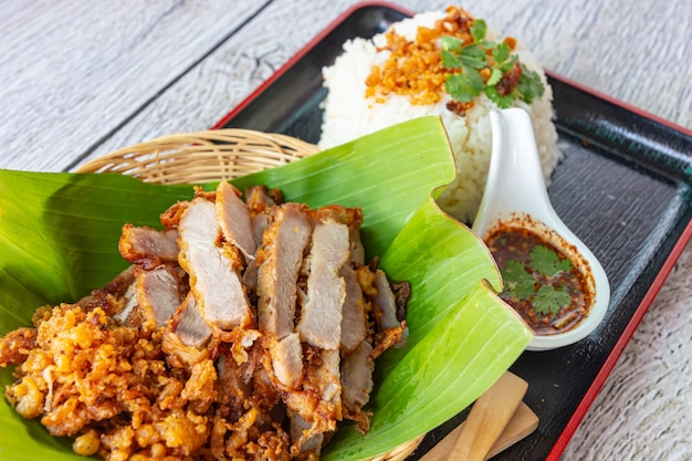 Fry pork with sticky rice and spicy sauce, close-up
