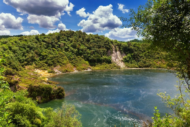 Frying pan lake view with steam in waimangu volcanic valley park in rotorua, new zealand