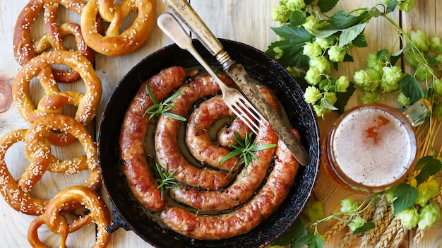 Frying pan with fried bavarian sausages