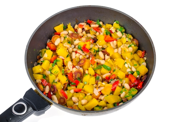 Frying pan with vegetable stew with pumpkin and white beans.