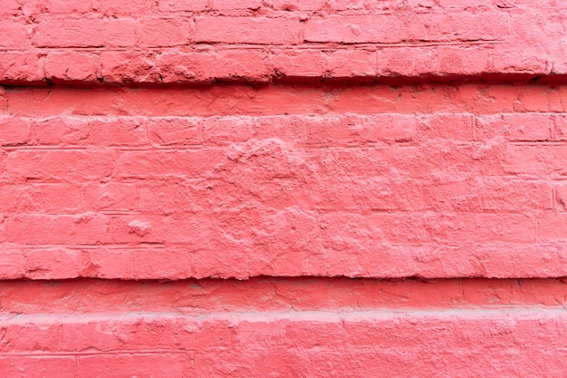 フクシアの石の壁。古い建物の外観。バックグラウンド。テキスト用のスペース。