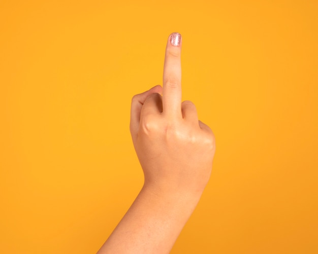 Fuck you hand gesture, yellow space