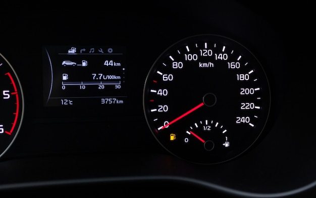 Fuel consumption theme. empty tank indicator on car dashboard