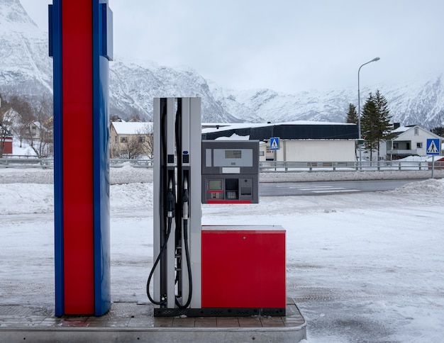Fuel dispenser with gas nozzle in gasoline station on winter at scandinavia