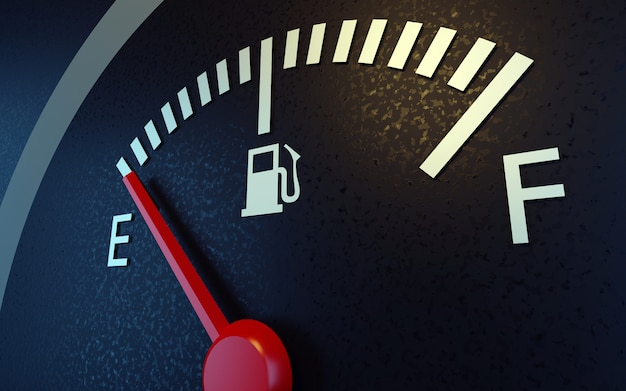 Fuel gauge with a red needle indicating empty.