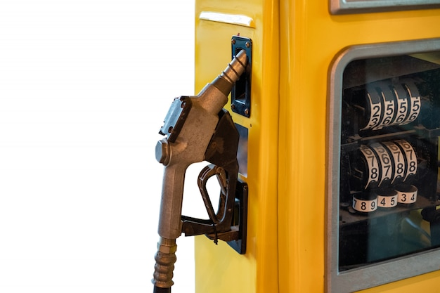 Fuel nozzle lock on yellow petrol pump on background