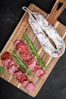 Fuet salami wurst cut in slices and whole sausage