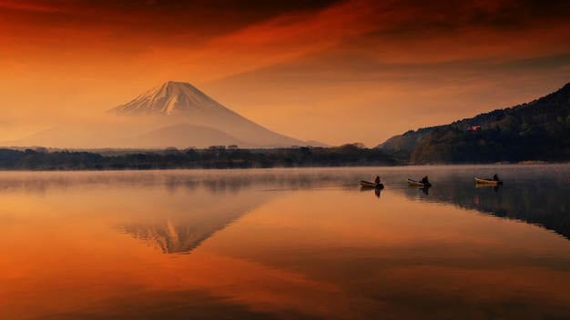 Fujisan at dawn in shoji lake with fishermen