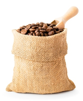 Full bag of coffee beans and wooden spoon