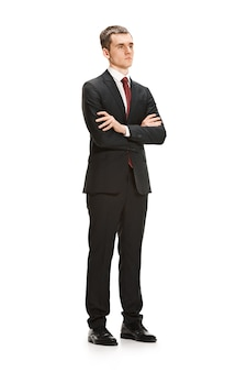 Full body or full-length portrait of businessman or diplomat on white studio background. serious young man in suit, red tie standing in office.