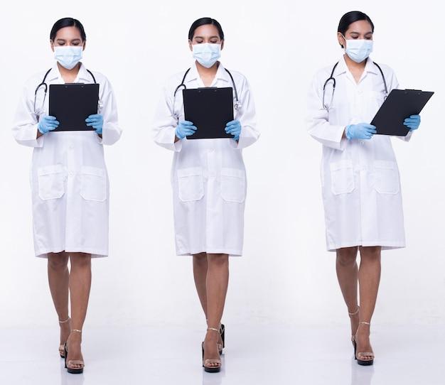20代のアジアの女性の全身の長さの図のスナップは、ドクターホワイトのユニフォームパンツのスカートと靴、白い背景を分離しました