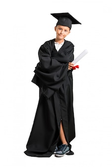 Full body of little boy graduating keeping arms crossed on isolated white background