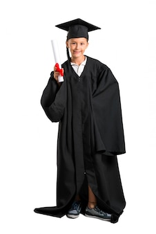 Full body of little boy graduating posing with arms at hip on isolated white background