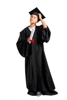 Full body of little boy graduating standing and thinking an idea