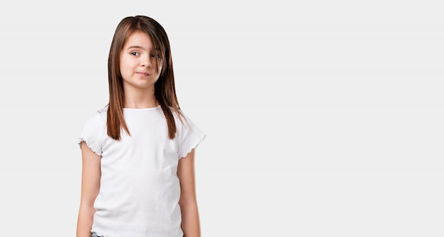 Full body little girl doubting and confused, thinking of an idea or worried about something